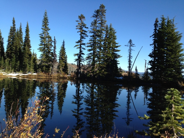 """One of the """"smaller"""" alpine lakes. It's amazing how clear and still the water is at that level."""